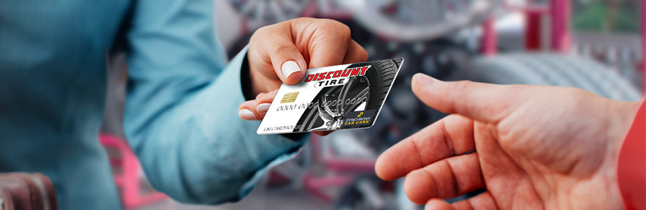 discount tire credit card handed to a person