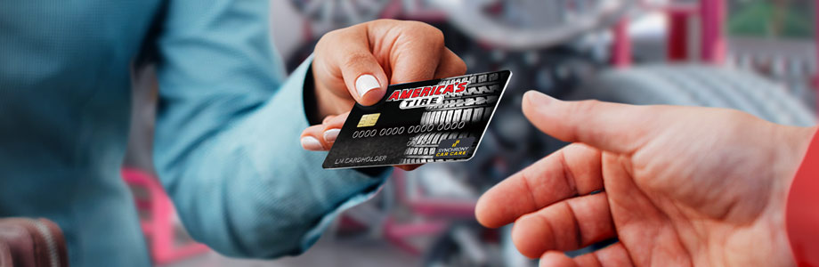americas tire credit card handed to a person