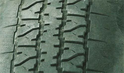 Underinflated tires (edge of tread worn)