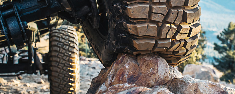 tires aired down on rocky terrain