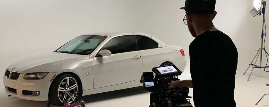white car in front of a video camera
