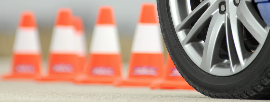 tires in front of orange traffic cones